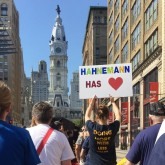 Staff and supporters walking down Broad Street at a rally on July 16th.