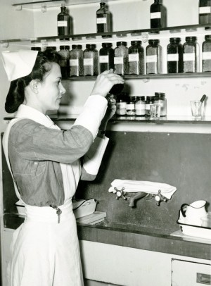 Student nurse preparing medication, Philadelphia General Hospital, Philadelphia, PA, c. 1940