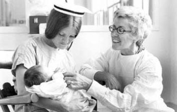 Nurse Practitioner Loretta Ford with unidentified nurse and baby