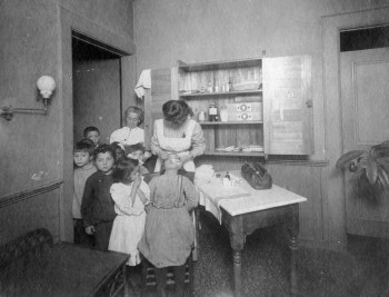 Visiting nurse at an elementary school examines a child's eyes, Visiting Nurse Society of Philadelphia, c. 1910