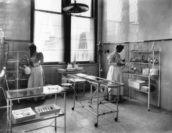 Two nurses in the J. William White private operating room, Hospital of the University of Pennsylv...