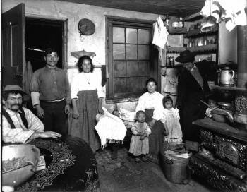 A visiting nurse visits an immigrant family's home, Starr Centre Association of Philadelphia, c. 1909