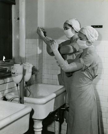 Nurses preparing for a surgical procedure, Philadelphia General Hospital, c. 1960