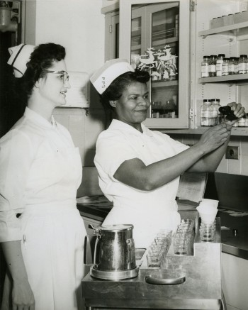 Registered nurse supervising licensed practical nursing student, Philadelphia General Hospital, c. 1950