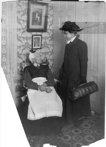 Visiting nurse with patient, Visiting Nurse Society of Philadelphia, c. 1910