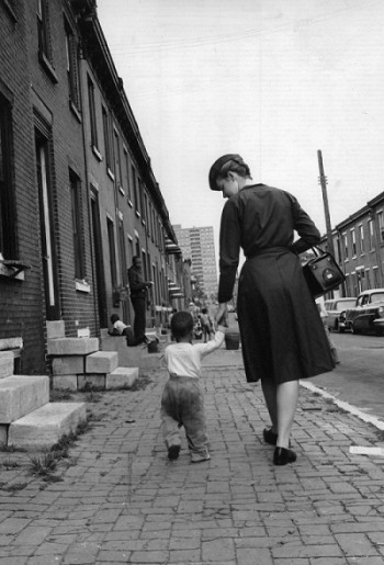 Visiting nurse Pera walks with young boy after she visits his mother, Community Nursing Services of Philadelphia, c. 1964