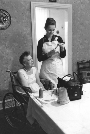 Visiting nurse prepares an injection for a patient, Community Nursing Services of Philadelphia, c. 1964