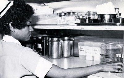 A student nurse collecting supplies for patient care, Philadelphia General Hospital, Philadelphia, PA, c. 1970