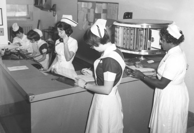 Staff and student nurses at the nurses station, Chestnut Hill Hospital, Philadelphia, PA, c. 1960